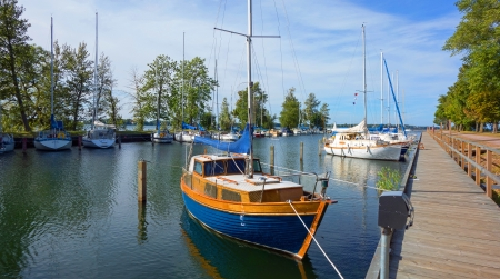 A picture of sailboats in the summer, docked in the harbor of an archipelago  photo