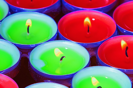 tealight: A closeup picture of some red and green tealight candles floating in a bowl of water  Stock Photo