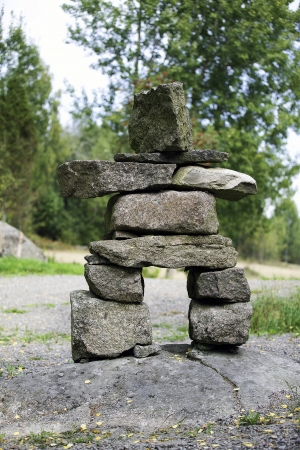 A picture of a few stones piled into a primitive statue of a standing man