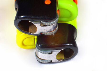 A macro shot showing the detail of two cigarette lighters, one stacked on top of the other  photo