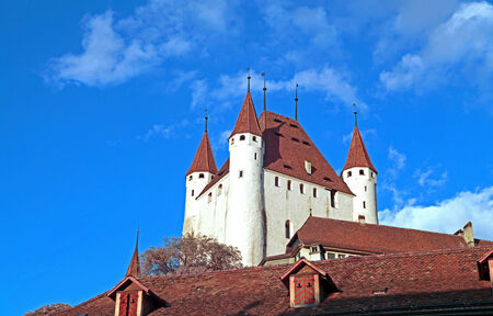 Part of a beautiful scandinavian medieval church seen from a perpective from below against the blue sky  photo