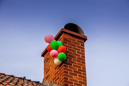 Ballons that got stuck on a chimney Reklamní fotografie - 64524762