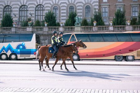 intimidate: Mounted police patroling, the area round the Swedish royal castle Editorial