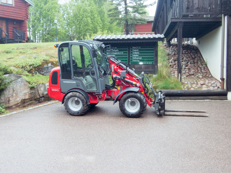 loader: Compact loader outside a hotel Editorial