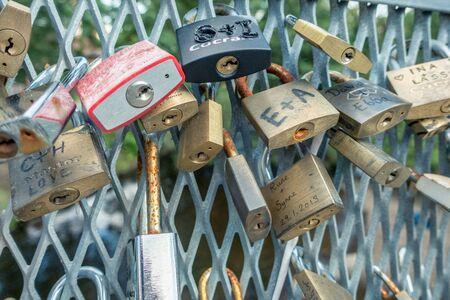 oslo, Norway - July 21, 2017: Love locks on a bridge near Norwegian National Academy of Fine Arts