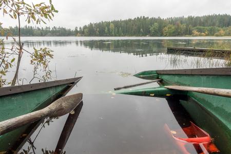 Partly submerged rowboat Stock Photo