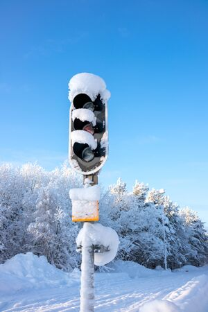 Snow covered traffic lights in winter 写真素材
