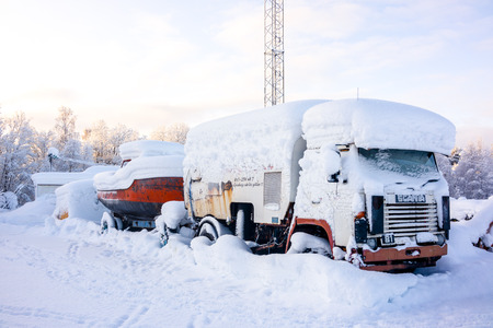 Kiruna, Sweden - February 3 2018: Parked truck with heavy snow on top