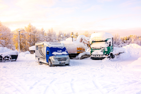 Kiruna, Sweden - February 3 2018: Parked vehicles with heavy snow on top