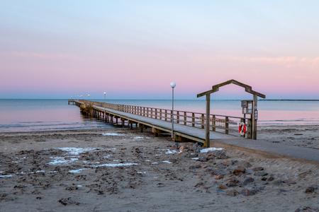 Falkenberg, Sweden - January 6, 2018: Skrea beach and pier on the Swedish west coast at sunrise