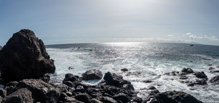 La Gomera  a rocky beach with the sun 写真素材