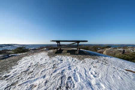Vrango in winter and a picknick table, this island is part of Southern Gothenburg Archipelago
