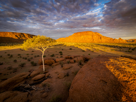 Beautiful sunset over the scenic landscape in Damaraland, Namibia