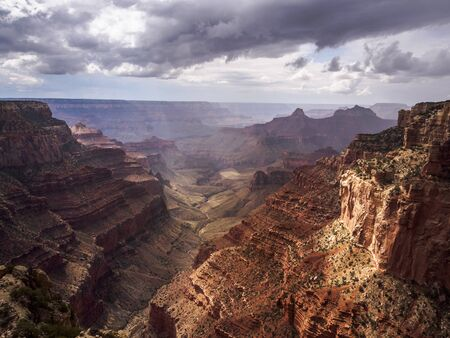 The sun splashing through the clouds during a thunderstorm over the Grand Canyon 免版税图像