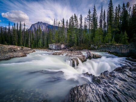 Water flowing over the rough natural rocks on the Icefield Parkway, Canada