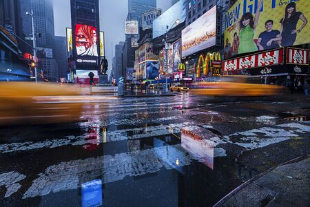 Yellow taxis on a rainy morning in the heart of New York City