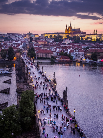 Tourists walking over the Charles Bridge in the background 新闻类图片