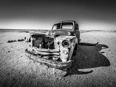 Wreck of car in the middle of the arid namibian desert 스톡 콘텐츠