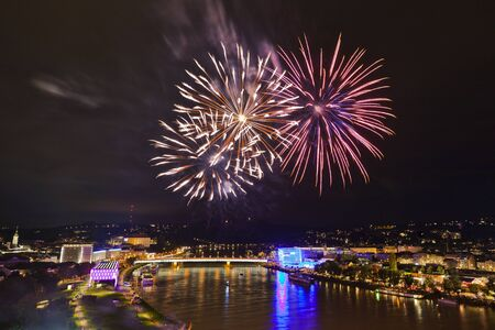 Beautiful firework over the river surrounded by the center of Linz, Austria