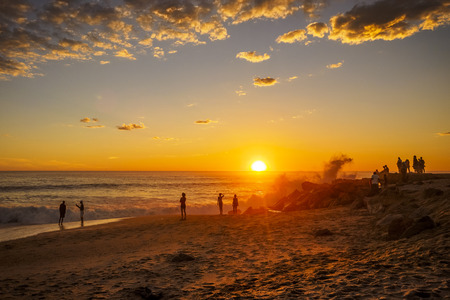 People in Swakopmund, Namibia enjoying the sunset at the beach