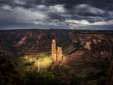 Spectacular spotlight on the spider-rock of Canyon de Chelly National Park during a thunderstorm