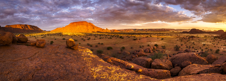 Panoramic view of an amazing sunset over the scenic landscape in Damaraland, Namibia