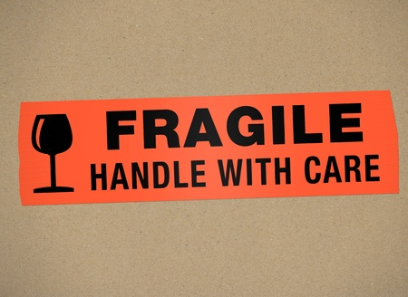 cardboard - Fragile Handle with care Stock Photo - 11295306