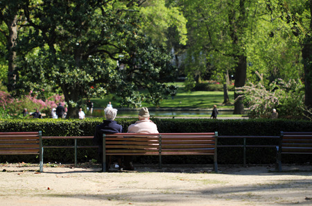 Retired couple on a park bench photo