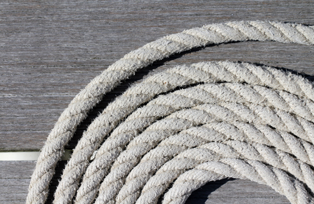coiled rope: Coiled boat mooring rope