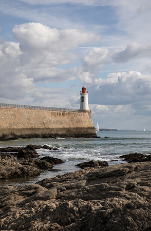 Red Lighthouse in Les Sables dOlonne - France Stock Photo