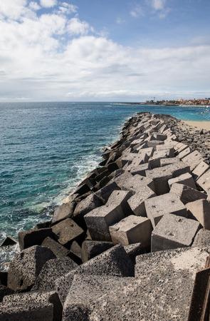 bulwark: Concrete blocks in the jetty of Los Cristiano (Tenerife - Spain) Stock Photo