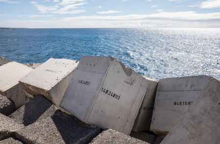 bulwark: Concrete blocks numbered in the jetty of Los Cristiano (Tenerife - Spain)