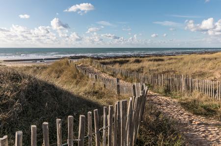 wooden fence: Path in the dunes towards the beach of la Paracou (Les Sables dOlonne)