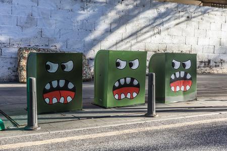 street art: Street art on trashs in Puerto de la Cruz (Tenerife, Spain) Stock Photo