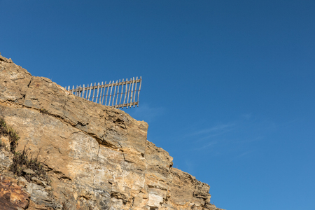 Fence after cliff collapse