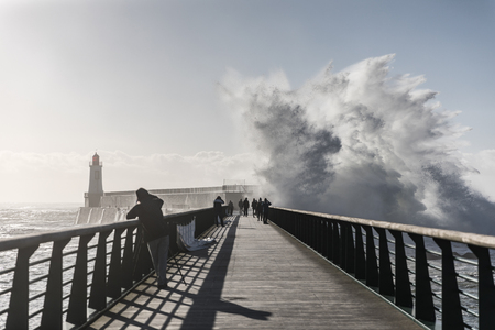 europe: Backwash on the great jetty of la Chaume (Les Sables dOlonne, France)