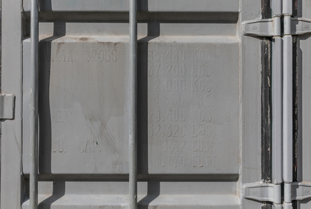 storage: Old Container repainted in gray over the specifications