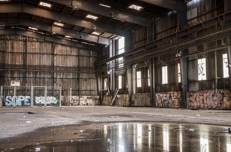 degrade: Large abandoned hangar