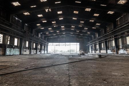 agonizing: Large abandoned hangar