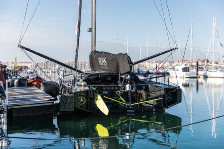 sponsors: LES SABLES DOLONNE, FRANCE – JANUARY, 21, 2017 : Skipper Alex Thomson boat Hugo Boss at the Vendee Globe pontoon the day after his arrival.