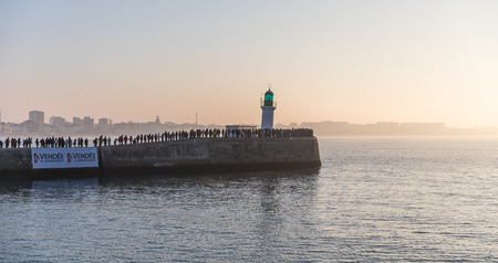 europe: LES SABLES DOLONNE, FRANCE – JANUARY, 20, 2017 : Spectators waiting the skipper Alex Thomson for the second place of the Vendee Globe race (Yacht race) on the little jetty of Les Sables dOlonne.
