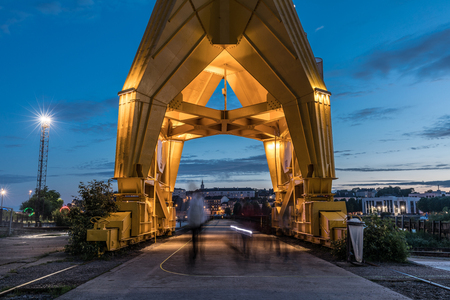 europe: Passage under the yellow crane titan by night in Nantes, France