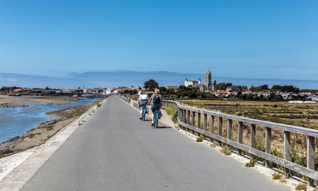 europe: Cycling on the Jacobsen jetty on the island of Noirmoutier (France) Stock Photo