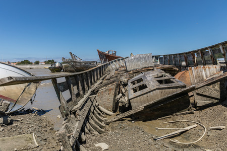 Wreck at the boat cemetery at low tide in Noirmoutier (France) Stock Photo