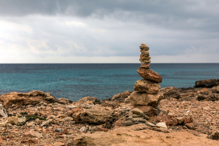 Rock balancing in Ses Saline cap on Majorca island (Balearic Islands, Spain)