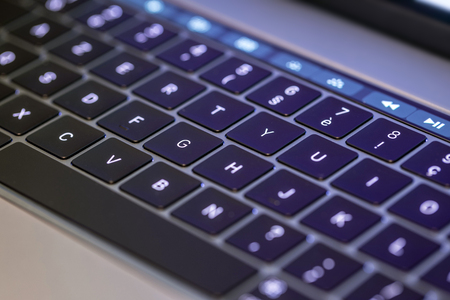 Bright keyboard and touch screen bar on laptop Stock Photo