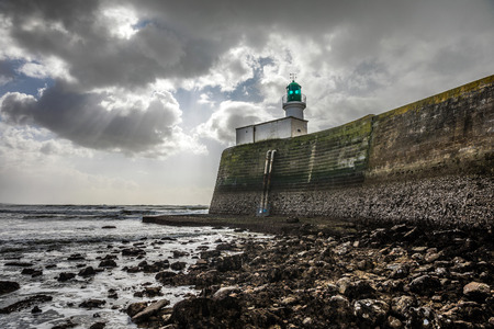 Lighthouse of the little jetty of les Sables dOlonne at low tide