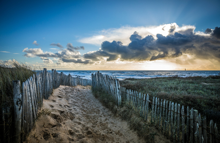 Fenced path to the beach of la Paracou in Les Sables dOlonne, France