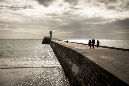 Walk on the little jetty of Les Sables dOlonne in the French west coast