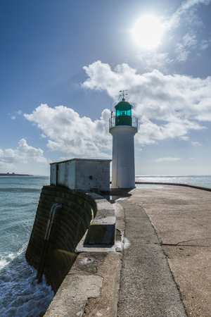Green lighthouse on the little jetty of les Sables dOlonne